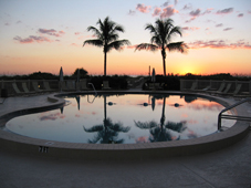 Island Reef condo pool at sunset.